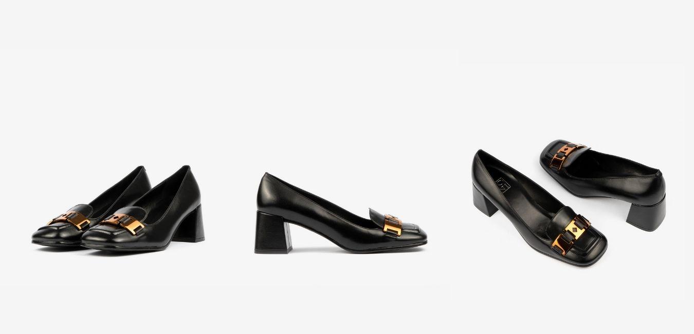La iamgen meustra unso zapatos de tacón. Este calzado de mujer es perfecto para cualquier ocasión, gracias a su color negro y a su tacón cuadrado podrás conquistar todos los outfits de la nueva temporada. Estos zapatos además, cuentan con la punta cuadrada y una hebilla dorada que hace que sea elegante y especial.